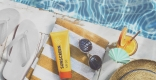 Sunscreen and sunglasses by pool